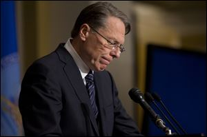 The National Rifle Association executive vice president Wayne LaPierre pauses as he makes a statement during a news conference in response to the Connecticut school shooting, on Friday.