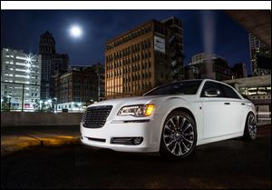 In the new ad, Detroit native Berry Gordy, who founded Motown Records, is driven through Detroit in a 2013 Chrysler 300 Motown Edition that ends up in front of a theater in Manhattan.