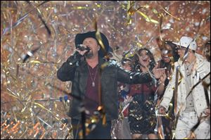 Season two winner Tate Stevens performs during THE X FACTOR Finale on Thursday night.