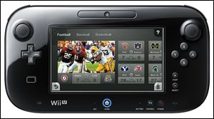 This undated photo released by Nintendo shows it's new controller for the new Wii U console. The new platform  transforms the tablet-like controller of the new Wii U console into a remote that changes the channel on your TV.