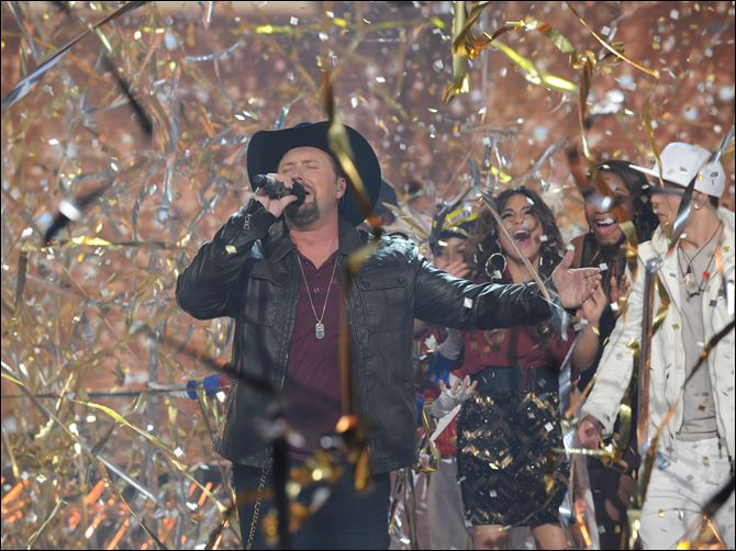 TV Fox X Factor Season two winner Tate Stevens performs during THE X FACTOR Finale on Thursday night.