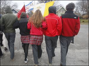 Central Catholic students link arms during the annual Advent Pilgrimage to Rosary Cathedral in Toledo, Ohio.