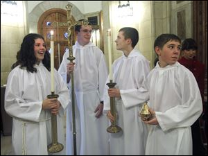 From left: Central Catholic students Megan Hoffman, Aaron Powers, Tony Mossing and Nate Oblizajek prepare to participate in Mass at Rosary Cathedral in Toledo, Ohio.