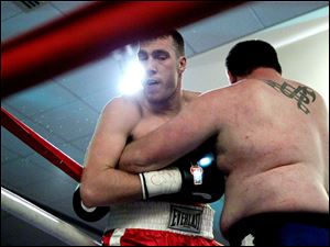 Jordan Shimmel, left, battles Lance Gauch, right, during their fight at the Purgatory Fight Series All Pro Boxing event.