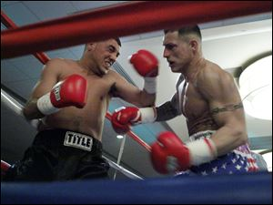 Masedonio Molina, left, and Wade Tolle Jr., right, trade punches during the second round of their main event at the Purgatory Fight Series All Pro Boxing event.