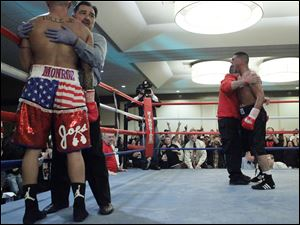 Referee Frank Garza holds Wade Tolle Jr. as he stops the fight after Tolle is knocked down by Masedonio Molina during the second round of their main event at the Purgatory Fight Series All Pro Boxing event.