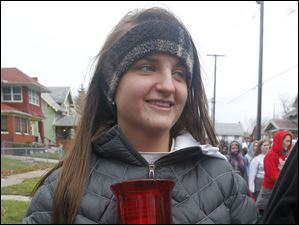 Central Catholic senior Allie Comes carries the student council candle during the annual Advent Pilgrimage to Rosary Cathedral in Toledo, Ohio.