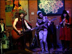 From the left, Adam Scheiber, Brandon James, Evan Close and Christina Schreiber, of Jack and the Bear, perform.