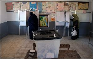 Egyptians cast their votes during the second round of a referendum on a disputed constitution drafted by Islamist supporters of President Mohammed Morsi in Fayoum, about 100 kilometers (62 miles) south of Cairo , Egypt, Saturday, Dec. 22, 2012.(AP Photo/Khalil Hamra)