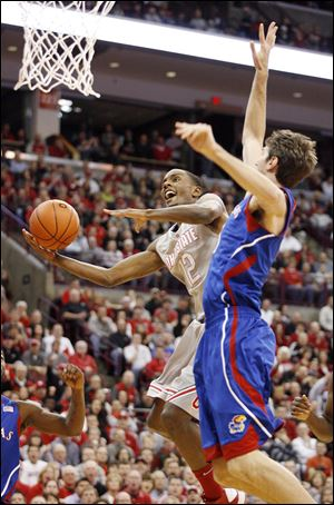 Ohio State's Sam Thompson scores in front of Kansas' Jeff Withey today in Columbus.