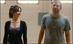 Jennifer Lawrence, left, and Bradley Cooper in