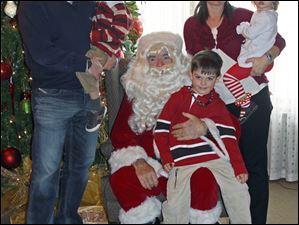 Jay and Shelene Morgan with Derek, Zack and Kennedy during a photo with Santa.