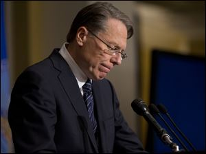 National Rifle Association executive vice president Wayne LaPierre pauses as he makes a statement during a news conference in response to the Connecticut school shooting, on Friday, in Washington.