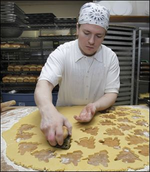 Baker Stephen Domanowski makes Christmas cookies at Wixey Bakery.