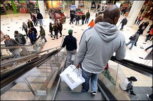 Holiday shoppers at the Twelve Oaks Mall in Novi, Mich., take advantage of more hours to shop and more sale items over the weekend as Christmas approaches.