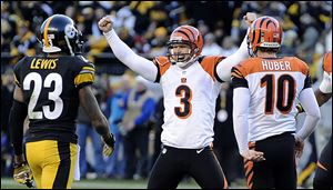 Cincinnati's Josh Brown celebrates hitting a 43-yard field goal with four seconds left to beat Pittsburgh and send the Bengals to the playoffs for a second straight season.