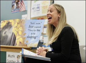 Sarah Adams sounds out letters for her kindergarten class at Martin Luther King, Jr. Academy for Boys. The lesson is part of the new Common Core curriculum being used by Toledo Public Schools.