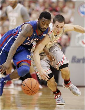 Ohio State's Aaron Craft, right scrambles for a steal against Kansas' Elijah Johnson. The Jayhawks shot 51 percent from the floor, while the Buck