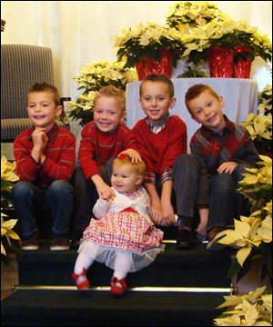 Blaine Schmitz, Will Coleman, Jack Coleman, Beckham Schmitz and little Madeline Coleman, front, children of Brooke and Brian Schmitz and Cynthia and Jeff Coleman, look forward to their time with Santa at Stone Oak Country Club.