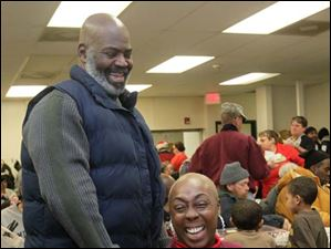 Toledo Mayor Mike Bell, left, shares a laugh with Mischell Montgomery, of Toledo.