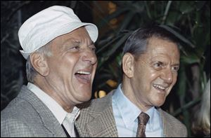 "In a 1992 photo, Jack Klugman, left, and Tony Randall laugh at a news conference announcing that they will reprise their most famous roles as Oscar Madison and Felix Unger respectively, for a one-night benefit performance of Neil Simons play, ""The Odd Couple"", in Beverly Hills, Calif."