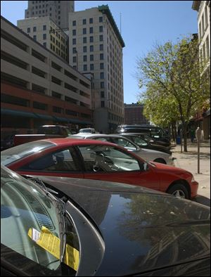 The Bell administration told the Downtown Toledo Parking Authority it could expand the types of tickets it writes to such spots as at fire hydrants and in loading zones and spaces for the disabled.