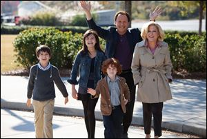 Billy Crystal as Artie and Bette Midler as Diane, who agree to babysit their three grandkids, from left, Joshua Rush as Turner, Bailee Madison as Harper and Kyle Harrison Breitkopf as Barker in a scene from the film,