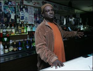 Suron Jacobs in his Central Avenue bar, Big Shots.