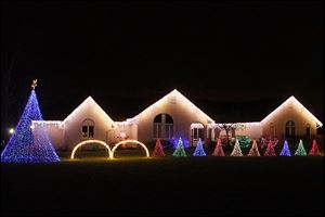 The Tawil family has a computer-controlled Christmas lights show, matched by a low-power radio broadcast of Christmas songs on 91.9 FM, in the front yard of their home in Oregon.