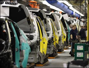 Two decades after BMW announced it would build an automotive plant in Greer, S.C., the factory's 7,000 employees in November produced more than 25,000 of BMW's crossover vehicles.