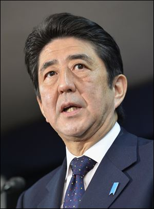 Japan's prime-minister-to-be Shinzo Abe speaks as he announces his top lieutenants today in Tokyo.