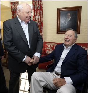 Former president George W. Bush, seen here last month with the former president of the Soviet Union Mikhail Gorbachev, has been in a Houston hospital since mid November.