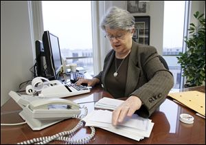 Lucas County Recorder Jeanine Perry says she attends to the smallest duties of the recorder's job, including making a daily deposit with the county auditor and treasurer of the day's receipts.