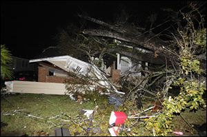 A house in the Midtown section of Mobile, Ala. is damaged after a tornado touched down Tuesday.