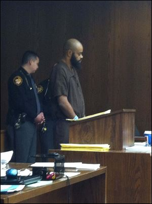 Robert Carter appears in Toledo Municipal Court Wednesday.