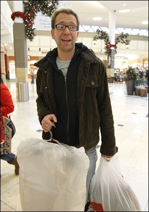 Ryan Osier, who was exchanging coats, found Wednesday's lighter crowd more laid back than the pre-Christmas shoppers.