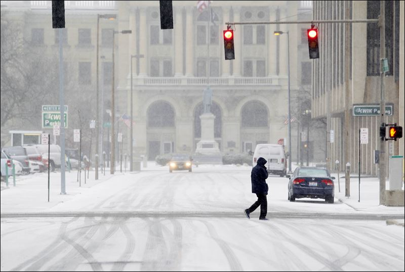 lone pedestrian crosses North Ontario Street near the Lucas County