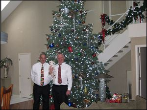 Eldon Smith, left, and John Nagel hosted the 'Eldon John' holiday party at their home that featured a 17-foot decorated tree.
