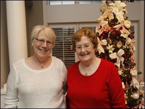 Bernie Thompson of Sylvania, left, and Barb Ball, of Sylvania Township, at the Toledo Yacht Club holiday party.