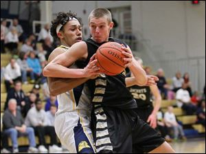 Whitmer High School player Chris Boykin, 20, defends Perrysburg High School player Shane Edwards.
