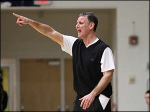Perrysburg High School head coach Dave Boyce shouts instruction to his team.