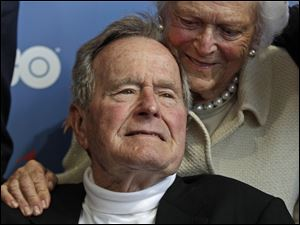Former President George H.W. Bush and his wife, Barbara, arrive for the premiere of HBO's new documentary about his life in Kennebunkport, Maine.