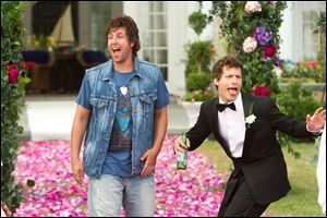 Adam Sandler, left, and  Andy Samberg in a scene from