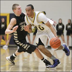 Whitmer's Ricardo Smith, who had 15 points, gets past Perrysburg's Shane Edwards in Thursday night's game.