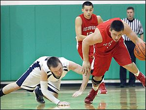 Bedford's Dennis Guss, right, steals the ball from Lakota's Nathan Ray during the second quarter. Guss scored 10 points.