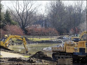 The Toledo Botanical Garden is dredging Crosby Lakes, the two artificial lakes in the garden, as part of the restoration project.