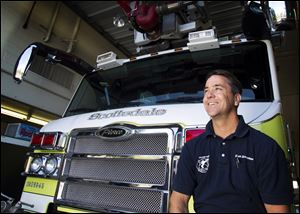 Scottsdale Firefighter Mark DeBruyckere poses at a fire station Dec. 23, in Scottsdale, Ariz. DeBruyckere is credited with helping to thwart a bank robber who tried to carjack motorists after robbing a bank in Scottsdale.