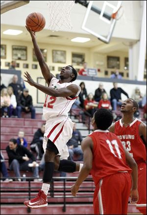 Central Catholic's C.J. Bussey, who had 13 points, goes to the basket against Bowling Green's Vitto Brown.
