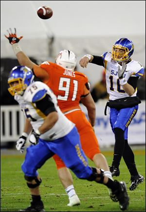 San Jose State quarterback David Fales passes against BG's Chris Jones. Fales completed 33 of 43 passes for 395 yards.