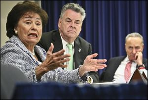 Congressman Peter King, center, and Senator Chuck Schumer, right, listens as Congresswoman Nita Lowey speaks during a news conference earlier this month.